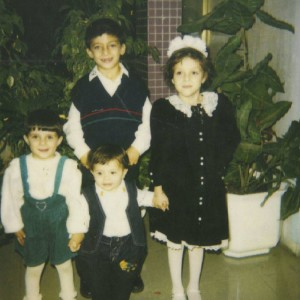 My brother Ezo, big sister Toha, my little sister Arkan and I (clockwise).