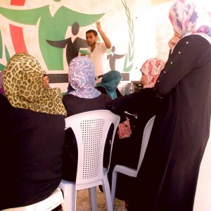 I try to encourage girls and women to be more involved in society.<br /> <br /> Women empowerment workshop, Gaza.