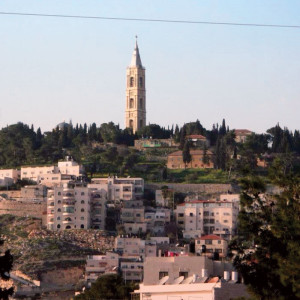 When I was about 13 years old, they started building the wall around my home in Abu-Dis. <br /> We were going to be stuck behind it.<br /> My parents were afraid to be cut off from Jerusalem, so we moved to the Mount of Olives.